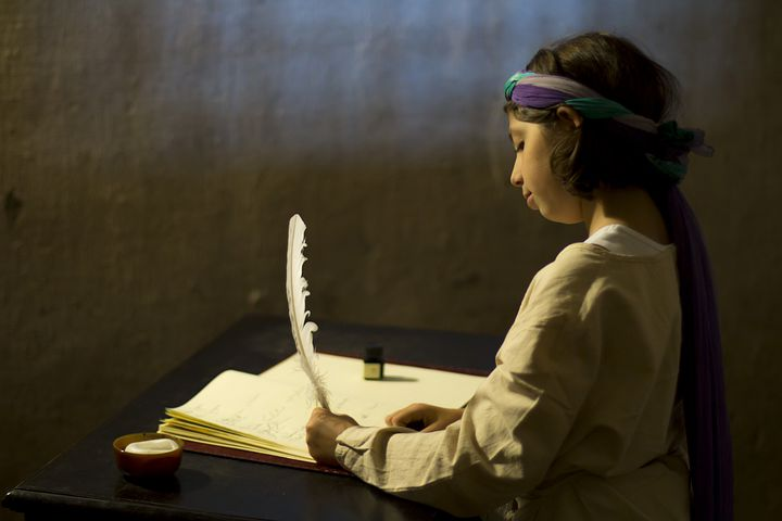 girl writing with goose pen